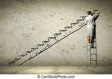 Woman standing on ladder drawing on wall - Image of...