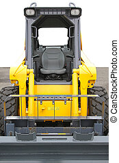 Skid steer front loader machine at construction site