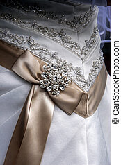 ribbon on a wedding gown - beige ribbon on a wedding gown...