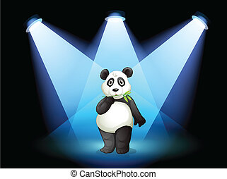 A panda at the center of the stage with spotlights