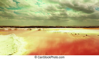 timelapse of stunning shallow sea made pink in colour from...