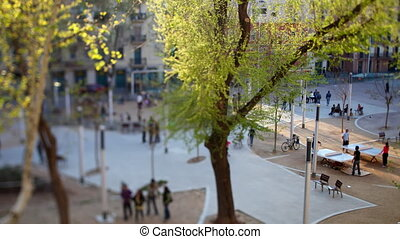 view of people walking about in a square in barcelona, spain