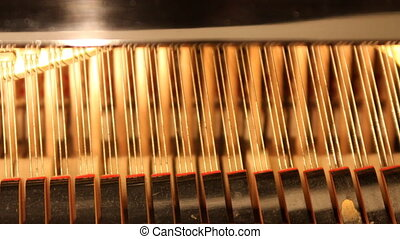 detail of piano hammers and strings
