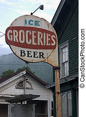 A rusted plain sign outside an old country store