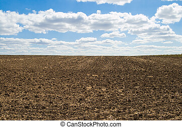 tillage - arable soil at autumn under blue sky