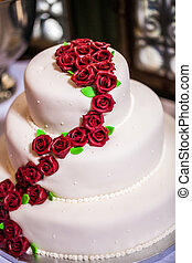 wedding cake - white wedding cake decorated with red...
