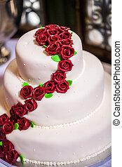 wedding cake - white wedding cake decorated with red...