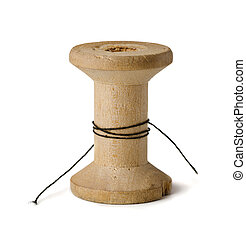 Wooden spool - Old wooden spool with leftover threads...
