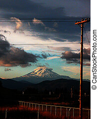 Surreal Sunset Lighting - Clouds and a power pole are cast...