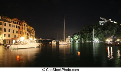 timelapse of portofino harbour at night, italy
