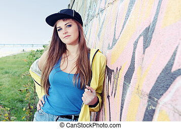 Beautiful Young Woman Teenager near Urban Wall