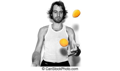 man juggling with balls