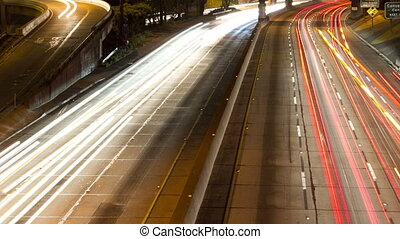 timelapse of traffic on freeway in downtown los angeles