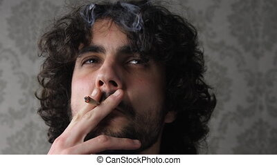 man smoking in a chair