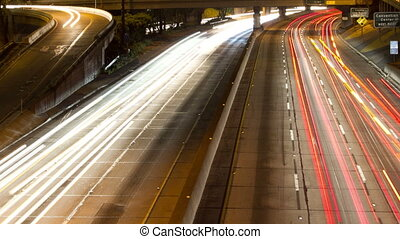 long exposure timelapse of traffic on freeway in downtown los angeles