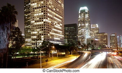 timelapse of traffic on freeway in downtown los angeles,...