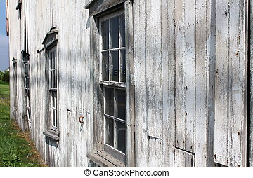 Side view of old weathered barn - Side view of four old...