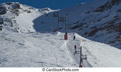 timelapse of skiers and the chair lifts in the french alp resort of la sauze