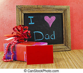 happy fathers day with present and blackboard with text i...