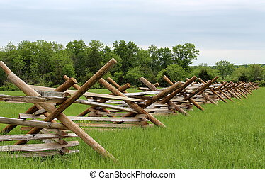 Criss cross fences along field - Simple lines of wooden...