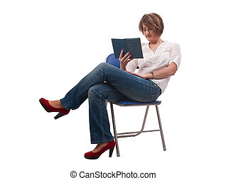 young woman with glasses sitting on chair and reading a book