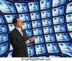 Man in suit monitoring babies on distorted video screens -...