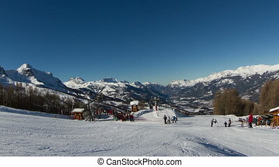 timelapse of skiers and the chair lifts in the french alp...