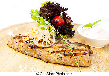 Salmon steak with herbs and lemon