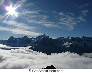 Top of the World - Sun shining over the clouds, taken from...