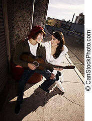 Musician and Pretty Girlfriend Downtown