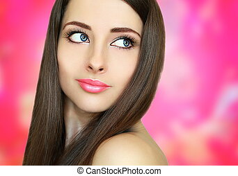 Beautiful woman face on pink background Closeup portrait
