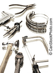 goldsmiths tools - different goldsmiths tools on white...
