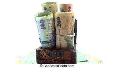 Romanian banknotes in old trunk rotating part 1