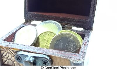 coins in the chest isolated in white