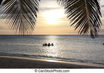 Roatan Sunset - Friend having fun at the beach, bright...
