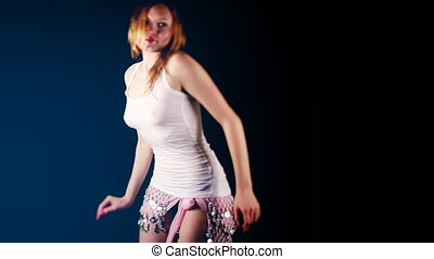 beautiful young blond woman dances in oriental style...