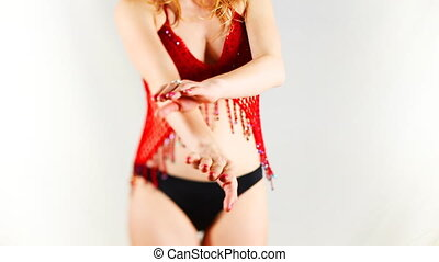 beautiful young blond woman dances in oriental style red top
