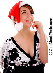 front view of cheerful woman in christmas hat against white...