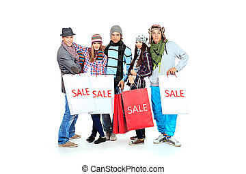 warm clothing - Group of cheerful young people with shopping...