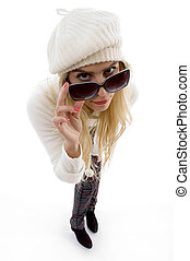 high angle view of woman looking through sunglasses on an...