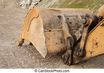 Tooths of digger - 3 - A yellow digger or excavator used to...