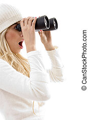 side view of amazed woman looking through binoculars on an...