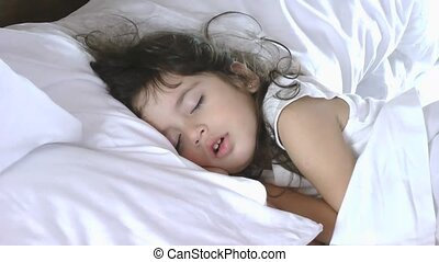 Close up of little girl sleep on bed