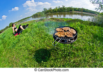 Woman during the bbq and sunbathing - Young woman during the...