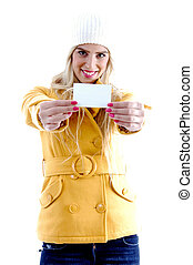 front view of smiling woman showing business card against...