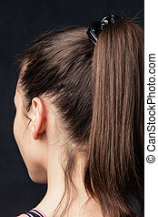 ponytail - closeup of a girl with ponytail studio shot