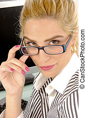 side view of businesswoman holding eye wear in an office
