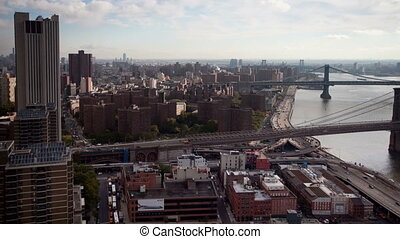 view of manhattan skyline and brooklyn bridge from a high...