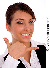 front view of cheerful woman making phone call hand gesture...