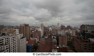 timelapse of midtown manhattan skyline from a high vantage point on a dull cloudy evening
